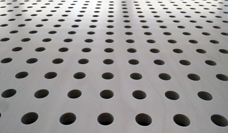 round holes on smooth metal surface